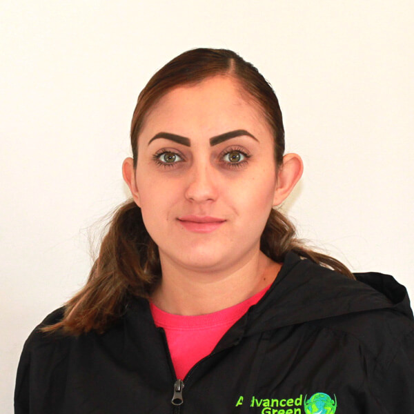 a women with nice brown eyes and a nice brows with neatly kept hair wearing a pink shirt and black jacket with the logo of advanced green cleaning Albuquerque