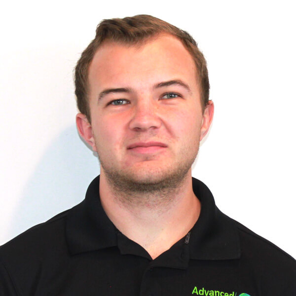 a blond man with receding hairline and a beard wearing black shirt with the company logo of advanced green cleaning Albuquerque