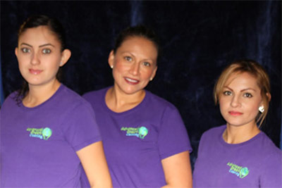 three ladies wearing purple shirt with advanced green cleaning logo