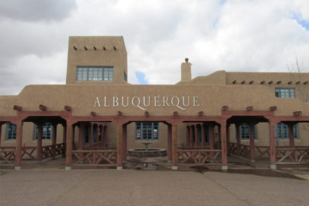 a mexican style building with Albuquerque word at the middle of the building