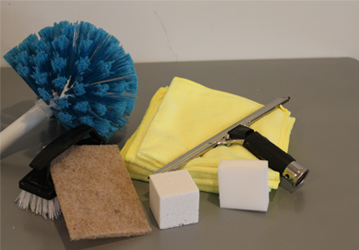 a blue microfiber mops and a cleaning cloth with brush and a silver squeegee