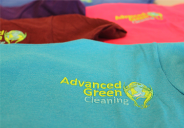advanced green cleaning shirts in different colors specifically blue, red, violet and pink, they all have the logo of advanced green cleaning